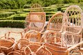 Wicker baskets and rattan armchairs at the fair Royalty Free Stock Photo
