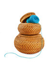 Wicker box of yellow color with dark blue thread Royalty Free Stock Photo
