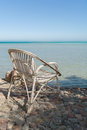 Wicker Chair on Beach Royalty Free Stock Photo