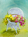 Wicker chair with flowers yellow and pink fill a basket on a white in an acrylic painting Stock Photos