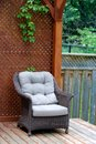 Wicker chair outdoor on a cedar deck Stock Images