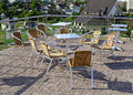Wicker chairs with metal legs and racks are in an open cafe area Royalty Free Stock Photo