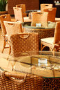 Wicker chairs and table in restaurant Stock Images