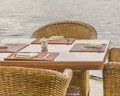 Wicker Chairs an Wood Table at Lake Royalty Free Stock Photo