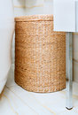 Wicker clothes basket in the bathroom Royalty Free Stock Photos