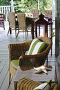 Wicker cottage furnishings outdoors living is relaxing and casual under a veranda with classic and accessories Stock Images