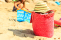Wicker handbag bag and hat on summer beach. Royalty Free Stock Photo