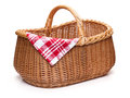 Wicker picnic basket with red checked napkin. Royalty Free Stock Photo