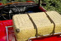 Wicker picnic basket on a red sports car Royalty Free Stock Photo