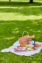 Wicker picnic hamper outdoors in a spring park Royalty Free Stock Photo