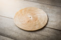 Wicker placemat on wooden table background Royalty Free Stock Photos
