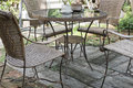 wicker rattan chair and table on patio in garden Royalty Free Stock Photo