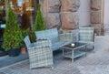 Wicker rattan furniture on pavement sidewalk cafe Royalty Free Stock Photo