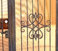 Wicket gate of hammered metal close up Stock Images