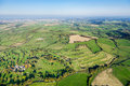 Wide angle aerial view of british countryside beautiful green in somerset uk includes rolling fields farms trees and a golf course Stock Photo