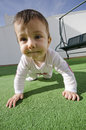 Wide angle baby full length portrait of crawling Stock Images