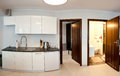 Wide angle panorama modern apartment detail kitchen bedroom door bathroom Stock Images