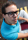 Wide angle portrait of young man in glasses Royalty Free Stock Image