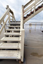 Wide angle view flight white stairs leading to lifeguard hut beach inclement winter day Stock Photography