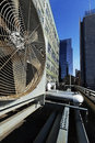 Wide angle view at an outdoor hvac air conditioner unit located on a high floor porch of a midtown manhattan skyscraper Royalty Free Stock Photos