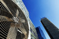 Wide angle view at an outdoor hvac air conditioner unit located on a high floor porch of a midtown manhattan skyscraper image Stock Image