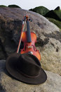 Wide Angle View of Violin and Cowboy Hat Lying  Royalty Free Stock Image
