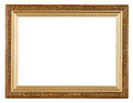 Wide gold picture frame with carved pattern isolated on white background Stock Photo