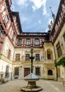 Wide interior courtyard view from the Peles Castle in Romania Royalty Free Stock Photo