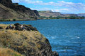 Wide open secret fishing spot a couple sturgeon with reel and pole on a bluff point in the columbia river Stock Images