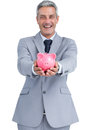 Wide smiling businessman holding piggy bank on white background Royalty Free Stock Photo