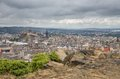 Wide view of edinburgh skyline with castle cloudy day Stock Images