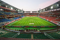 Wide view on empty stadium moscow aug with footboll field after the game in the evening august in moscow russia Royalty Free Stock Photo