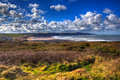 Widemouth Bay North Cornwall near Bude UK with blue sky and bright white clouds in HDR Royalty Free Stock Photo