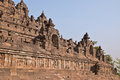 Widening view of Borobudur at the base with plenty of small stupas and buddha statues Royalty Free Stock Photo
