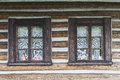 Widows in wooden building Royalty Free Stock Photo