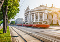 Wiener ringstrasse with burgtheater and tram at sunrise vienna austria famous historic imperial court theatre traditional red Royalty Free Stock Photos