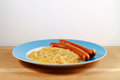 Wiener and sauerkraut a pair of sausages with wholemeal bread Royalty Free Stock Images