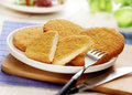 Wiener schnitzel served on a white plate with fork and knife Royalty Free Stock Images