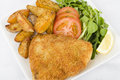 Wiener schnitzel veal steak breaded fried butter served salad potato wedges lemon slice Royalty Free Stock Photography