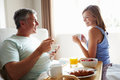 Wife Bringing Husband Breakfast In Bed On Tray Royalty Free Stock Photo
