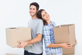 Wife and husband carrying boxes in their new house happy Stock Photo