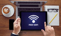 WIFI SIGNAL connectivity concept: Free wifi area sign Royalty Free Stock Photo