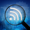 Wifi symbol in magnifying glass on blue background Royalty Free Stock Photo