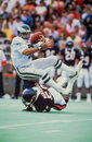 Wilbur marshall sacks ron jaworski chicago bears star takes down eagles qb image taken from color slide Royalty Free Stock Images