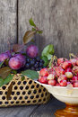 Wild apples plums and berries aronia in a vase plum in a basket Stock Photos