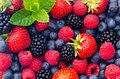Image : Wild berries strawberries, blueberries, blackberries, raspberries - Closeup photo coffee time different