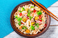 Wild and brown rice with mussels, squid, shrimps, top view Royalty Free Stock Photo