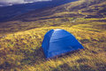 Wild camping with tent on mountain top Stock Image