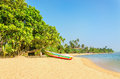 Wild and exotic Asian beach with colorful boat Royalty Free Stock Photo