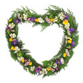 Wild flower wreath heart shaped over white background Stock Photo